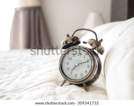 vintage style of alarm clock with bells, on the bedroom morning
