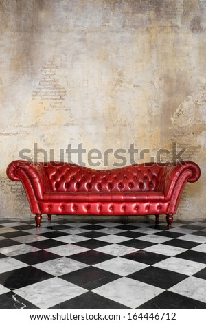 vintage style of interior decoration the leather sofa with black and white floor and concrete wall - stock photo