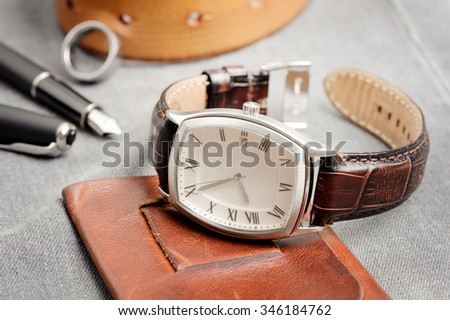 vintage style of luxury men watch with stainless case and leather strap - stock photo