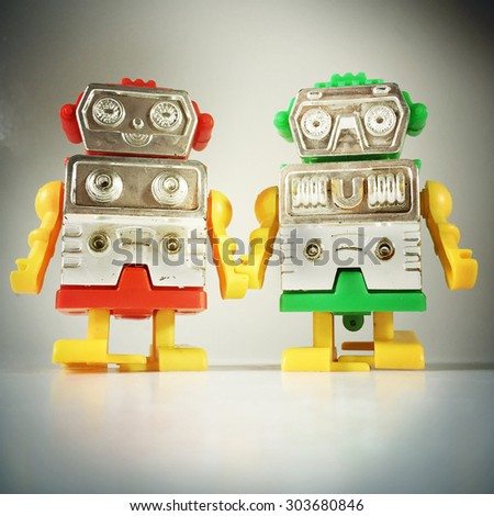 Vintage style of Robot couple holding hands with an Instagram style filter - stock photo