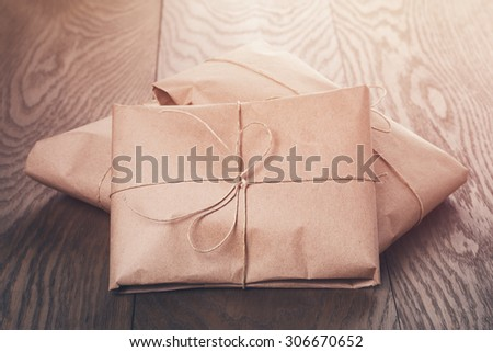 vintage style parcels wrapped with rope, toned photo - stock photo
