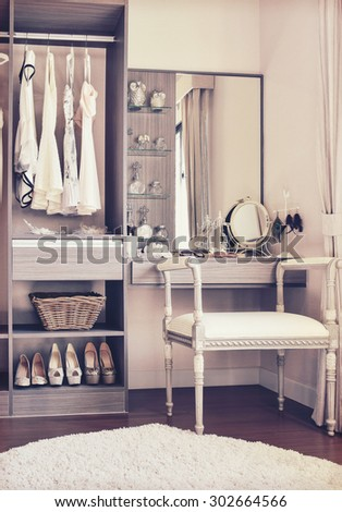 vintage style photo of dressing room with classic white chair and dressing table - stock photo