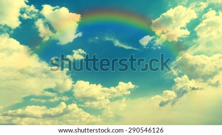 Vintage style Photo of the beautiful blue sky and white clouds with rainbow in good weather and summer day.  Photo for background. - stock photo