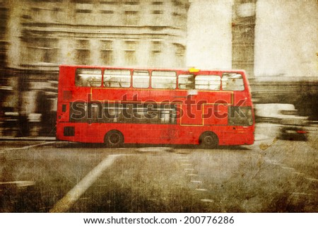 vintage style picture of a red London Bus in motion blur in the city of London - stock photo