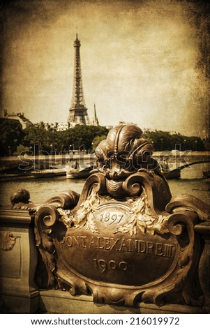 vintage style picture of a view from the Pont Alexandre III over the Seine to the Tour Eiffel in Paris, France - stock photo