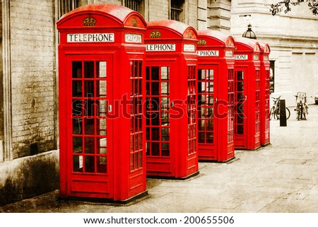 vintage style picture of British phone boxes in London - stock photo