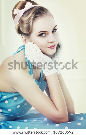 Vintage style portrait of cute smiling blonde teenager girl