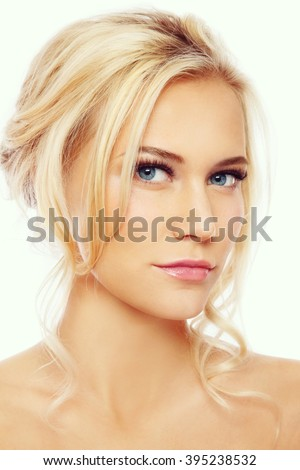 Vintage style portrait of young beautiful blond girl with natural make-up