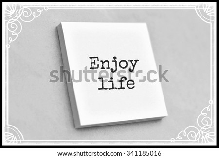 Vintage style text enjoy life on the short note texture background - stock photo