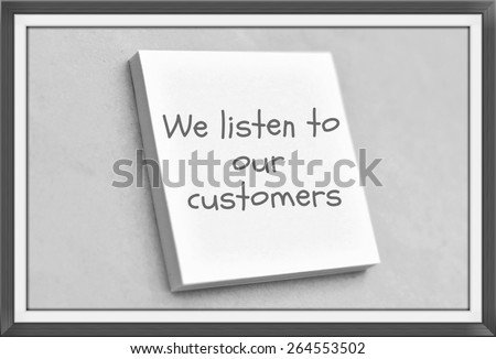 Vintage style text we listen to our customers on the short note texture background - stock photo