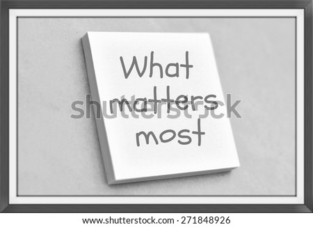 Vintage style text what matters most on the short note texture background - stock photo