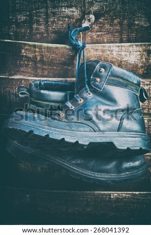 vintage style work boots - stock photo