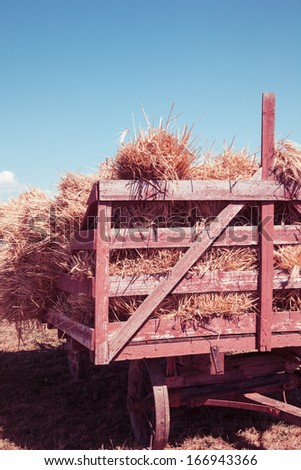 vintage styled image of a wagon full of hay - stock photo