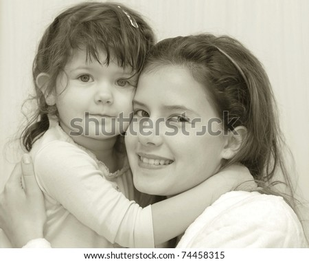 Vintage styled portrait of beautiful teenage and baby girl