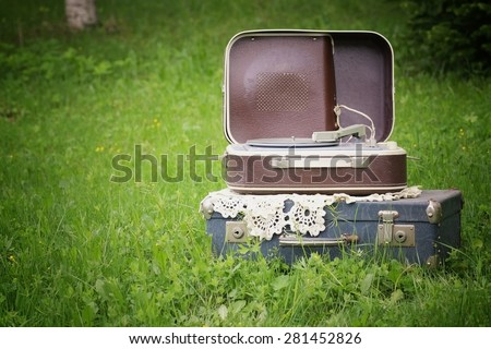 Vintage suitcase player on nature