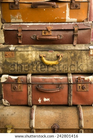 vintage suitcases in a pile waiting for dispatch from a station - stock photo