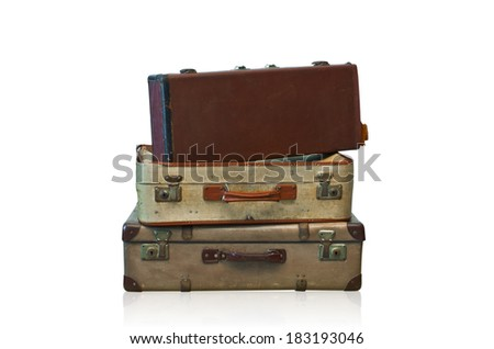 Vintage suitcases stacked isolated on white background with clipping path.