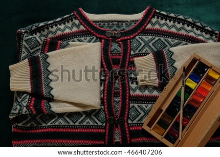 Vintage sweater with an ornament and colors