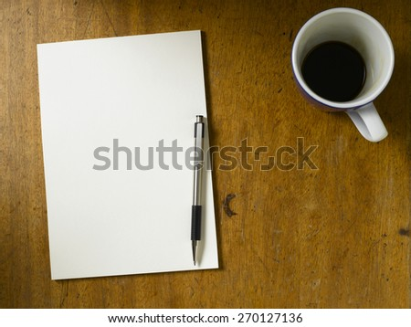 Vintage table top with blank paper - stock photo