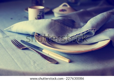 Vintage tableware, cutlery with retro effect and natural light - stock photo