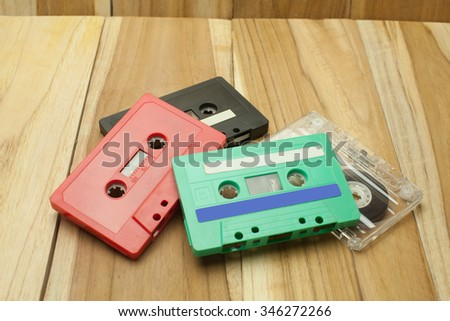 Vintage Tape cassette on wooden table - stock photo