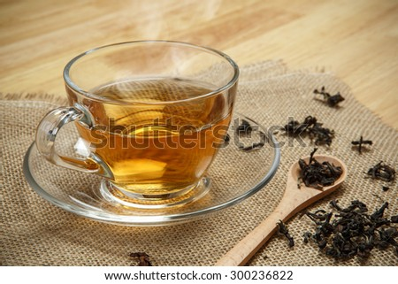 Vintage tea and leaves tea on sacking background - stock photo