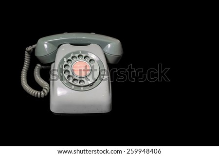 Vintage Telephone Isolated on black background. - stock photo