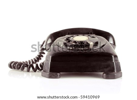 Vintage telephone on a white reflective background