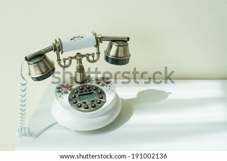 Vintage telephone on the table - stock photo