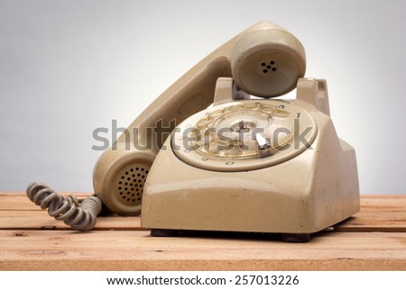 vintage telephone on wood background - stock photo