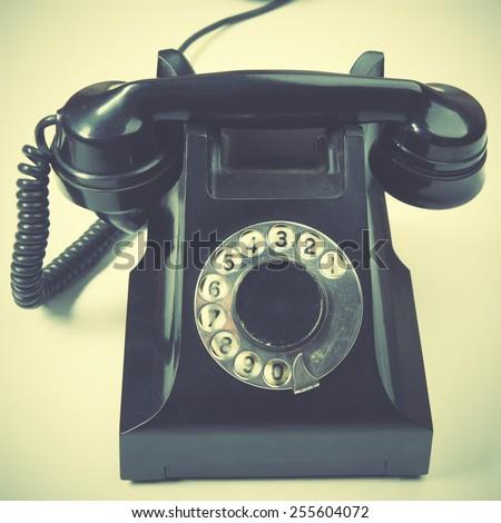 Vintage telephone. Retro style filtred image - stock photo
