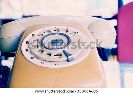 Vintage telephone with a rotary dial mechanism - stock photo