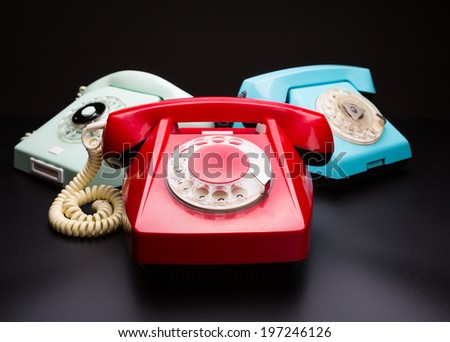 Vintage telephones on white - stock photo