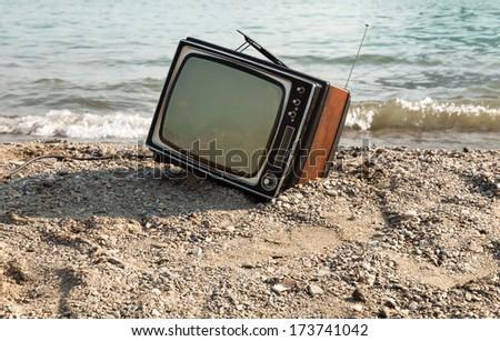 vintage television on the lake shore  - stock photo