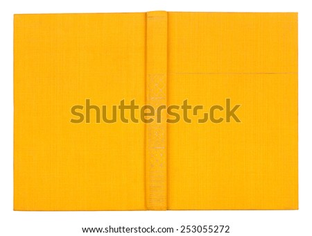 Vintage textile yellow book on an isolated white background - stock photo