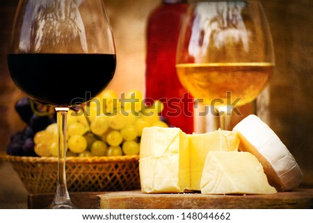 vintage textured still-life food background with cheese,  wine and grape - stock photo