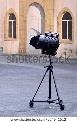 Vintage theater spotlight on a movie set stage. - stock photo