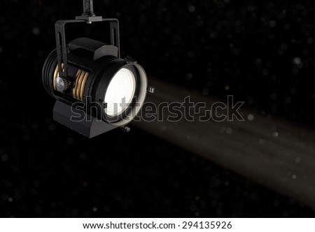 Vintage Theatre Spotlight on Dark Background with Dust Particles