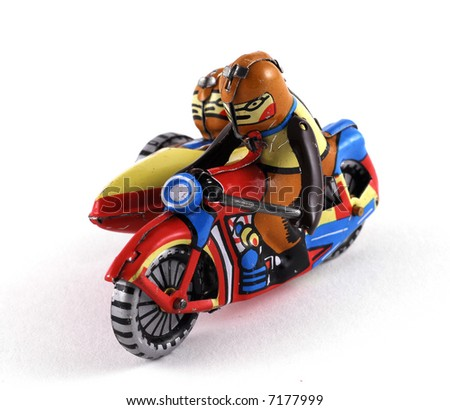 Vintage Tin Toy of a motorbike with sidecar - stock photo