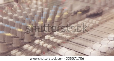 vintage tone blur image of modern sound mixer panel .