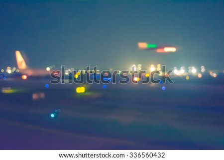 vintage tone blur image of runway in night time with bokeh for background usage. - stock photo