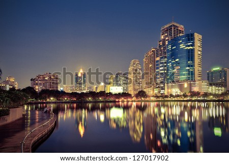 Vintage Tone,City downtown at night with reflection of skyline - stock photo