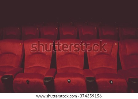 vintage tone of Empty rows of red theater or movie seats - stock photo