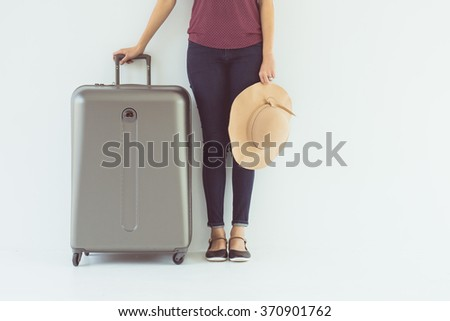 Vintage tone of  Exciting Asian woman drag a luggage - stock photo