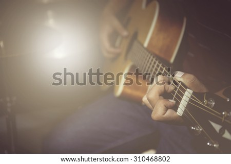 Vintage tone of guitarist plays - stock photo