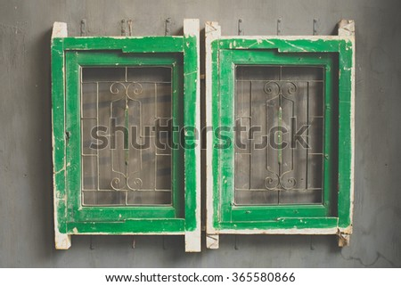 Vintage tone of Window with shutters on the facade - stock photo