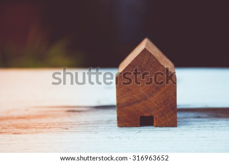 Vintage tone of wooden toy house - home purchase mortgage concept - stock photo