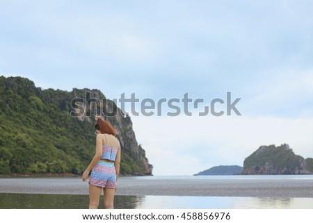 vintage tone, rain this morning,Woman enjoying a rainy fall day on the beach - stock photo