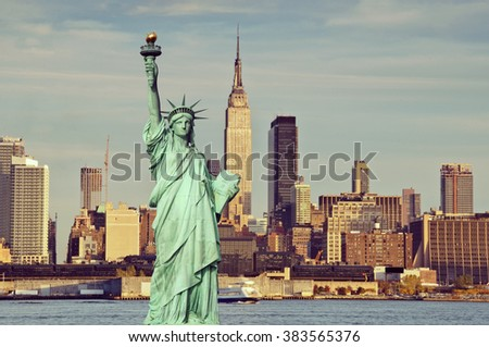 Vintage toned, Instagram effect filter from  New York empire state building with statue of liberty - stock photo