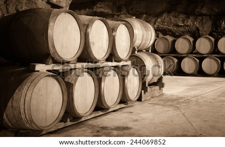 Vintage toned photo  of  winery cellar with   barrels  - stock photo